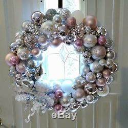 Handmade ornament christmas wreath in pink, silver, and white